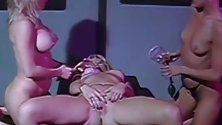 Strapon dykes going naughty in fruit threesome