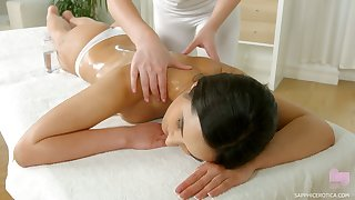 Two libidinous babes are the fate of and eating each others pussies on the massage table
