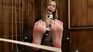 Bastinado for submissive girl with fishnet stockings