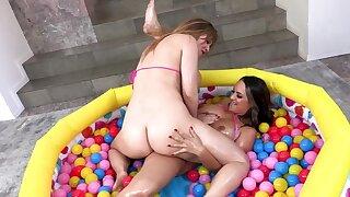 Girls masturbate assholes using purple vibrator in the ball pit