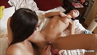 girl on girl naked fucking a dildo